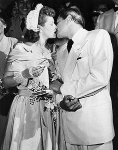 Lucille Ball and Desi Arnaz kiss on their wedding day, June 22, 1949