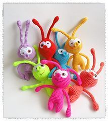 Cute little colourful aliens. Click here for the free pattern.
