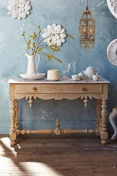 what a great way to use old ceiling light surrounds and ornate wall plaster moulds , as wall art , you can paint them whichever colour you want to fit your kitsch, contemporary or vintage chic interior design theme too diy details #anthrofave