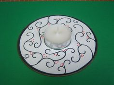 "Craft for ""City of Ember"" program (2012-2013). Decorate a blank CD lable put it on an old scratched CD or DVD and hot glue an tea light in the center."
