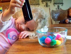 Activity for developing fine motor skills.  Tongs, pompoms, paperclips and a bowl.  Easy!