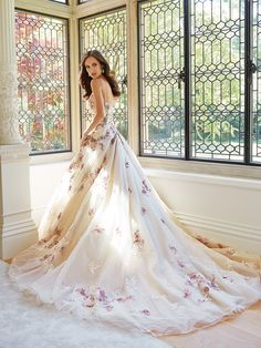 backless ball gown style wedding dress with floral details