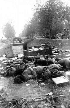 WW2. Summer of 1941. German troops moving pass dead Soviet refugees