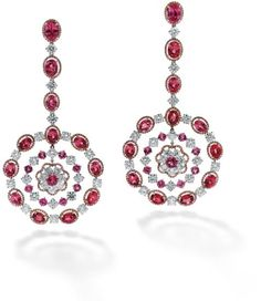 Each designed as a central circular-cut spinel and brilliant-cut diamond cluster within a scalloped pink diamond border suspended within a similarly cut pink spinel and diamond cluster, within a further border of diamond and oval-shaped spinel and pink diamond clusters, to a surmount of similar design, length 9.5 cm, maker's mark for Michael Youssoufian, in signed box.