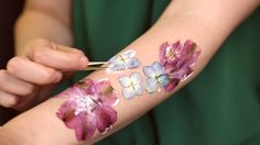 Dried flower tattoos are real. Are you a fan of the trendy temporary flash tattoos that popped up at Coachella this year? If you're looking for a unique twis...