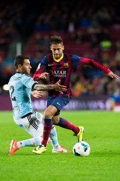 Neymar Santos Jr of FC Barcelona (C) fights for the ball with Hugo Mallo of RC Celta de Vigo during the La Liga match between FC Barcelona and RC Celta de Vigo at Camp Nou on March 26, 2014 in Barcelona, Catalonia.