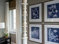 Window treatments are artwork are beautiful in this space.