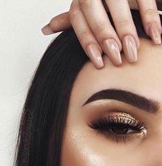 makeup. gold eyeshadow. lashes.