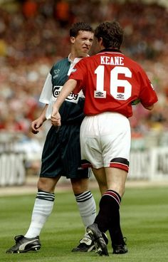 Robbie Fowler (Liverpool) and Roy Keane (Manchester United) exchange pleasantries during the 1996 FA Cup Final.