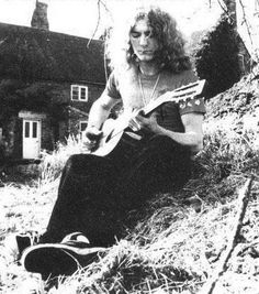 Robert Plant with a guitar - So rare, I've got to pin it!