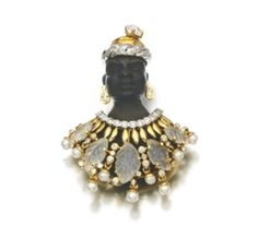 Quartz and diamond Blackamoor brooch -  The body composed of carved wood decorated with carved foliate quartz, brilliant-cut diamonds and seed pearls, Italian assay mark.