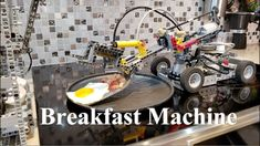 The LEGO Breakfast Machine is an amazing LEGO-built contraption, created by The Brick Wall, that is capable of frying up, seasoning, and serving bacon and Lego Robot, Lego Toys, Robots, Smart Home Appliances, Kitchen Appliances, Cooking Bacon, How To Make Breakfast, Recipe Of The Day, Breakfast Recipes