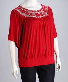 Crocheted lace decorates the neckline of this darling top, while a banded waist ensures a figure-flattering fit.