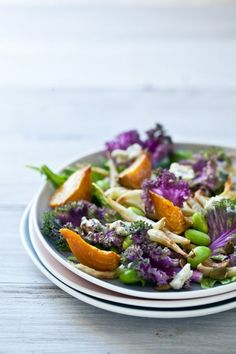 Roasted Vegetable Salad. Place a handful of purple kale at the bottom of two plates or bowl, top with the roasted vegetables, add about 1 oz of blue cheese to each plate and top with pumpkin seeds and dressing.