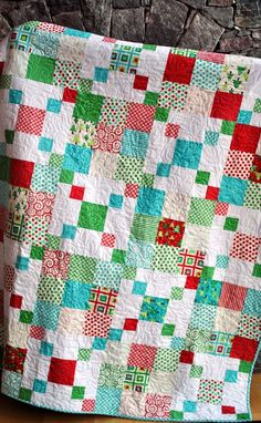 Rocky Road ~ with different colors.  ~ Perfect design, but with some darker colors (dark green, dark blue, blue, beiges/tan, maroon, dark red~most with very small floral prints~NO white). 100% Cotton fabric and dense cotton batting. Full Size dimensions. Dark Red Brick backing and with VERY compact   (close together) swirly quilting in med/dark red thread.   LOVE!