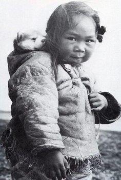 Little Eskimo/Inuit girl and her Husky pup