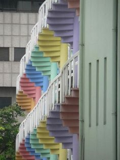 These spiral staircases painted in candy colours belong to the backs of narrow shophouses in Singapore. From Stairporn.