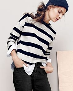 J.Crew women's striped long-sleeve T-shirt with shirttail hem, slim broken-in boyfriend jean in Durrand wash and beanie. To pre-order, call 800 261 7422 or email verypersonalstylist@jcrew.com.