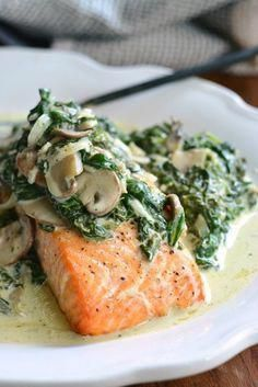 This delicious, easy dinner is made with juicy, tender, baked salmon and topped with creamy spinach and mushrooms. dinner salmon Salmon Florentine Recipe - Will Cook For Smiles Fish Dishes, Veggie Dishes, Seafood Dishes, Seafood Meals, Healthy Dishes, Healthy Meals, Salmon Florentine Recipe, Healthy Salmon Recipes, Salmon Spinach Recipes