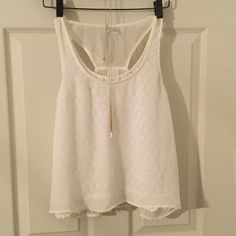 Sheer overlay tank top Cute and unique . This top features a lace underlay with a sheer overlay. Very pretty but there is a tiny tiny pin head stain on the front that is barley noticeable and a bit more noticeable spot on the shoulder. Priced accordingly Lauren Conrad Tops Tank Tops