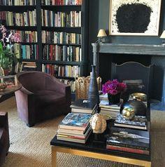 Chic, dark-walled home library - floor-to-ceiling bookshelves - natural fiber carpet - Aerin Lauder
