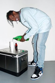 Travis Scott wearing  Jordan 1 Fragment Sneakers, Fan Merchandise Travis Scott Hood Toyota Long Sleeve T-Shirt