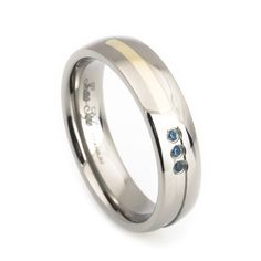 Woman's cute blue topaz titanium wedding ring