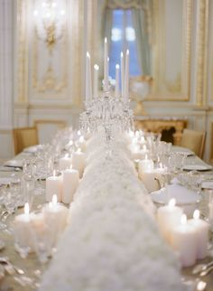 white floral candlelight table runner | Photography: Greg Finck