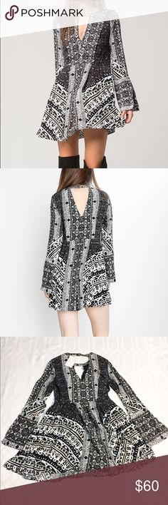 Free People Tegan Printed Mini Dress NWT XS Exuding an eclectic, artisanal vibe, Free People's festival-ready mini dress indulges your inner boho babe - Designed for a loose fit - Round neck, long bell sleeves, slit cuffs, bust cutout - Pleated bib and skirt, concealed side zip closure - Two side slit pockets, button closure at nape, back cutout - Rayon Free People Dresses Mini