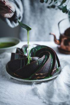 Cheesecake filled chocolate bundt cake with white chocolate matcha glaze