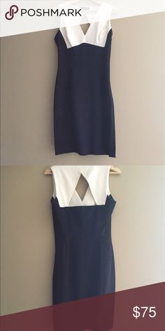 Cocktail dress from Banana Republic New dress. Made in the Phillipines.Wide back opening.With a Navy Blue,Black,White Fabric.Front V neck Banana Republic Dresses Asymmetrical