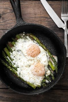 A simple spring dish that is comprised of just Asparagus and Eggs then topped with a sprinkle of cheese- easy breakfast at it's best.
