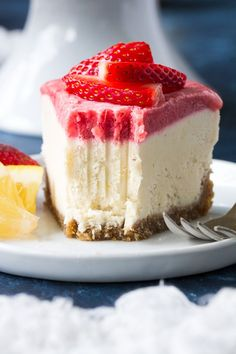 This no-bake Paleo and vegan cheesecake has a chewy, naturally sweet crust, topped with a thick creamy lemon layer and a sweet creamy strawberry layer.