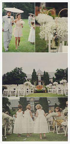 Bridesmaid dress, baby's breath, parasols @Laura Jayson Fritz