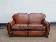 Leather 2 seat club sofa. Reupholstered in a hand coloured leather.  origin: UK