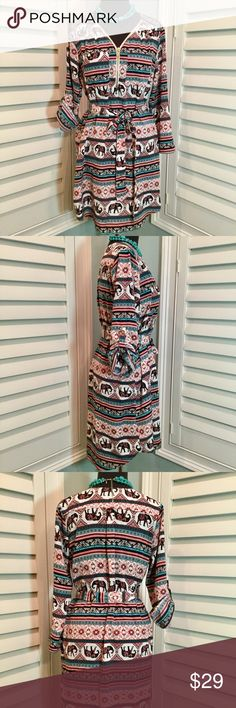 """Elephant Tribal Print Dress, Small, Like New Fun tribal print dress in a striped pattern with elephants. Colors include black, cream, brown (kind of a maroonish brown), blush pink, turquoise. Zipper front, breast pockets and long sleeves with button tab for optional roll-up. So stinkin' adorable! Like new condition. ****Smoke free home****  Details 🔹Shirt dress style with belt and shirt tail hem.  🔹100% polyester  🔹Measurements: armpit to armpit 20"""", back center length 35.5"""" Stella Tweed…"""