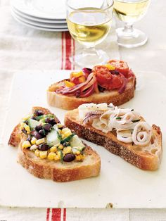 A single baguette, sliced and used as a foundation, yields a host of easy-to-assemble appetizers. Prepare toppings the day before and add them just before serving. Offer guests small plates and forks to scoop up the extras. Recipes: Bruschetta Tomato and Olive BruschettaMarinated Calamari with FennelGrilled Corn and Black Bean Salsa   - CountryLiving.com