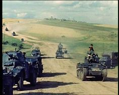 Column including Panzer 38(t), captured French Panzerspahwagen (armoured car) & trucks drive Eastward during the  Summer of 1941, in the USSR. Germany invaded on Sunday, June 22 (Operation Barbarossa) with over 3 million troops & started the largest campaign in history - in terms of area, men involved & casualties