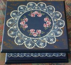 Tiny pink roses surrounded by hand painted lace were painted by Val de Vries (South Australia) on this wooden box.