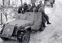 """Armored reconnaissance jeep of US 82nd Airborne Division, Ardennes Forest, Belgium, Dec 1944. The armor was a quick """"aftermarket"""" job to offer rudimentary protection to driver and passenger and to the front of the engine compartment. The armor could defeat up to rifle rounds but was rather thin when it came to machine gun fire and shrapnel."""