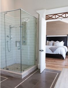 California Beach House with Transitional Interiors   Beveled subway tiles are repeated once again in the master bathroom. I love the texture it added to the space.