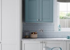 Faringdon Shaker ultra smooth painted thin shaker style kitchen in Porcelain and Winter Teal – First Impressions