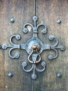 An ornate central door boss and pull on the main hall entrance door at Croft Castle.