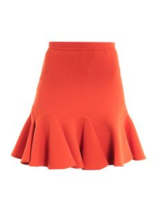 Guillaume Henry loosened his grip on the super-groomed Carven girl this spring and this fiery coral-red crepe skirt is Parisian chic with a hint of flirtatious frill; try it for the office for a hint of off-beat charm.