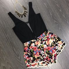 clothes t-shirt shorts top jewels floral black flowered shorts tank top short blouse necklace playsuit dress romper pink jumpsuit sexy flowers low-cut floral pattern fashion beautiful playsuits floral playsuit helpmeplease flowered shorts flowered shorts crop top girlie flowers black shirt gold necklace black necklace cute party jumpsuit pink
