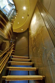 """Review: Lurssen Yachts 224' """"Kismet"""" - Stairs decorated by a bronze bas relief artwork- there is also an elevator."""