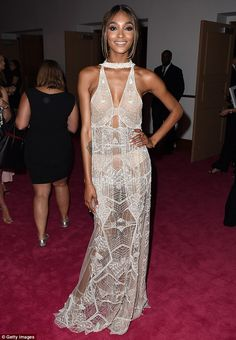 Incredible: Jourdan Dunn showed off her toned figure in a sheer beaded dress by designer J...