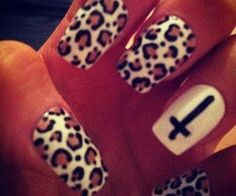 Crosses and cheetah print... My two fave things! They match my room at the salon!