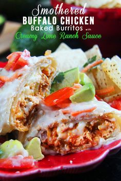 Smothered Buffalo Chicken Baked Burritos with Creamy Lime Ranch Sauce - Carlsbad Cravings -  The flavors in this are INCREDIBLE!  MUST TRY!