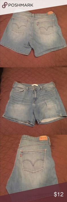 Comfy Levi Shorts Levi shorts excellent condition, light wash, free of any flaws. Size 14, lg 32 Levi's Shorts Jean Shorts